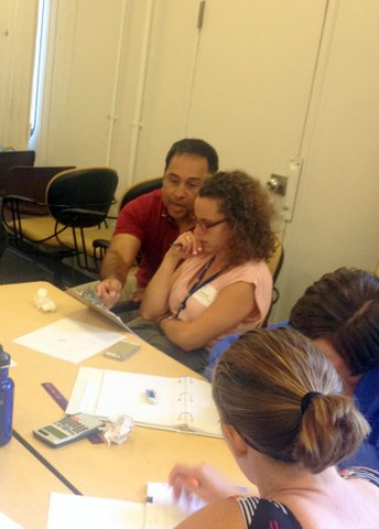 Dr. Ovie Soto, MfA SD senior associate, works with a guest teacher at the MfA SD Summer Institute's Visitors Day, July 9.