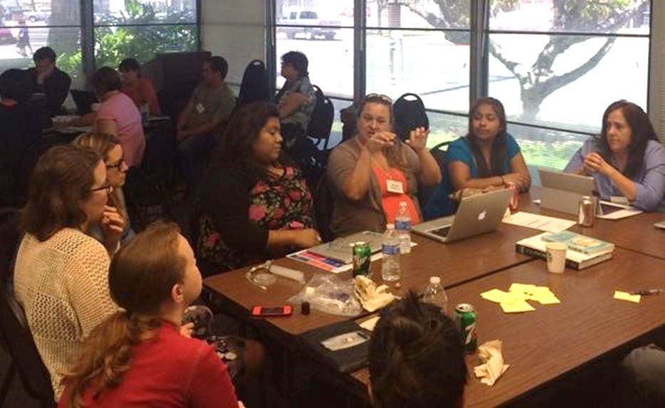 Melanie Villanueva, Chula Vista High School chemistry teacher in SUHSD, (in orange, center and below) works with her teacher team on NGSS-aligned lesson planning. (Photo credit above: Twitter SD Unified STEM @sd_STEM)
