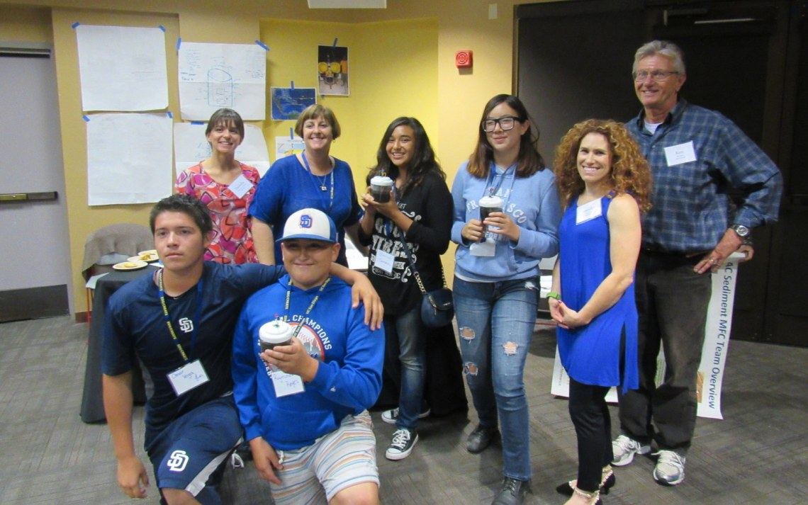 "The ""Schewbacca"" Microbial Fuel Cell Team Teachers Danielle Vincent-Griffith (Crawford High School) (top left), Julie Walker (Rancho del Rey Middle School), Jen Ekstein (Bonita Vista High School), and SPAWAR researcher Ken Richter (right) with environmental science students from Bonita Vista High School."